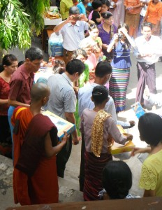 On of the Koyins, a Novice Monk after being ordained as a Full Monk, receiving the donation of gifts and money.