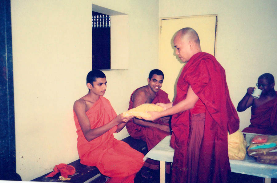 Sayadaw offering a robes Dana, donation on his birthday, Sri Lanka.